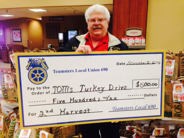 Local 690 Secretary-Treasurer Val Holstrom with Tom's Turkey check